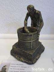 Teefigur - Backen oder Rösten von Teeblättern